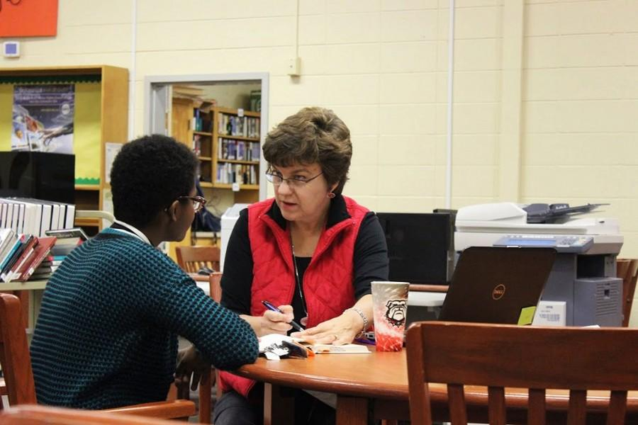 "Laurie Porter helps senior Krystal Washington write an annotated bibliography. ""She is really helpful and I believe she wants us to succeed. I feel confident about my annotated bibliography with her guidance,"" Washington said."