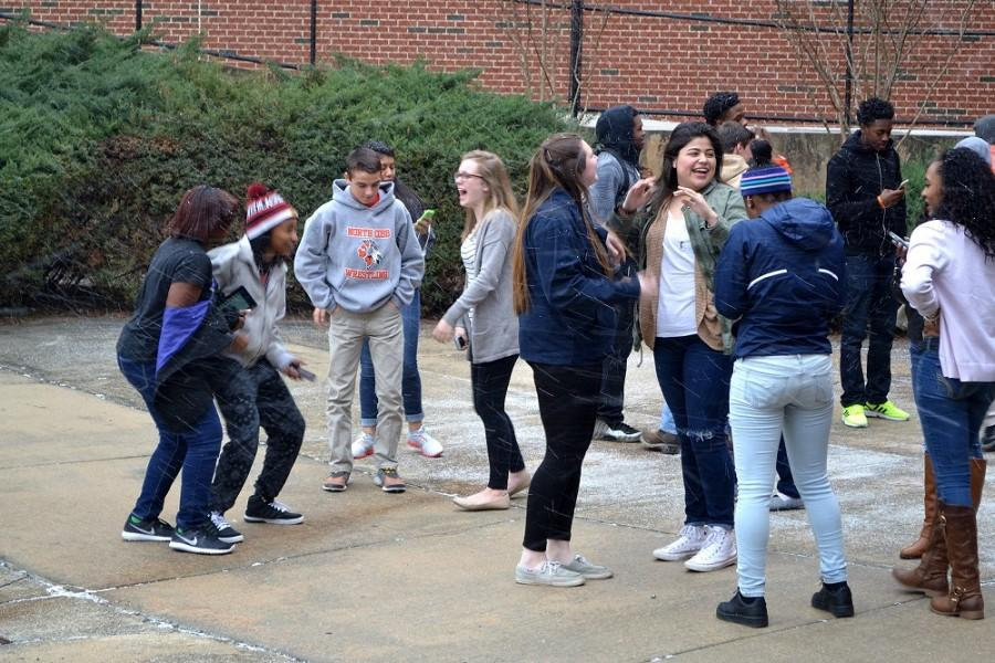 Mrs. Brown's class takes a moment to go outside and enjoy Kennesaw's first surge of snow.