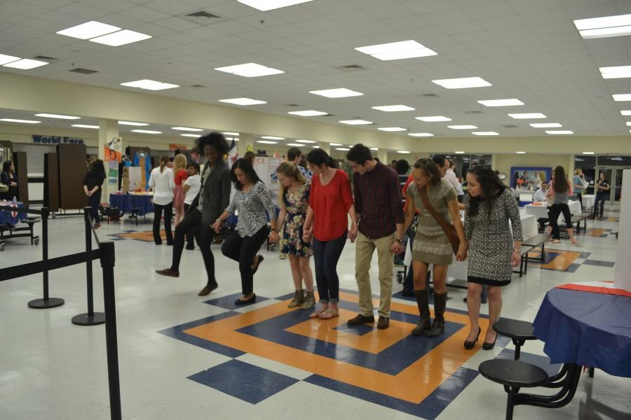 In the midst and mix of International Night and Open House, Arabic teacher Mrs. Ayoub teaches volunteer seniors Jacky Banos, Anshena Latimore, Giovani Velez, Katie Ledford, Catherine Lamb, and Judy Stubblefield an ethnic dance while music played.
