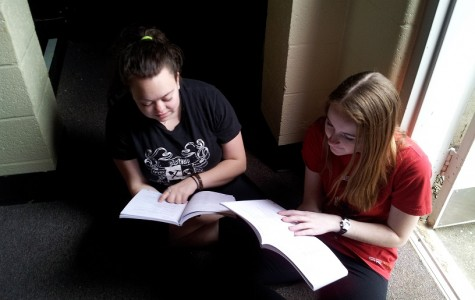 Actresses Jessica Sloan (playing Chutney) and Kat Shambaugh (playing Sabrina/Ensemble) rehearse lines between scenes. With the show less than three weeks away, every second of rehearsal becomes precious