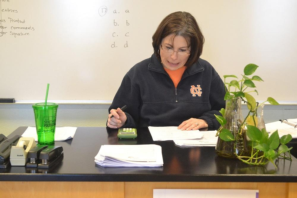 """Chemistry and ASR teacher Mrs. Tippens struggles to fix her class schedules and still keep on top of grading her classes' work. """"I'm just trying to get caught up but it seems like it's hard to cover everything now. There's no time since the snow days have happened and sometimes it's difficult to decide what's important and what's important,"""" she said."""