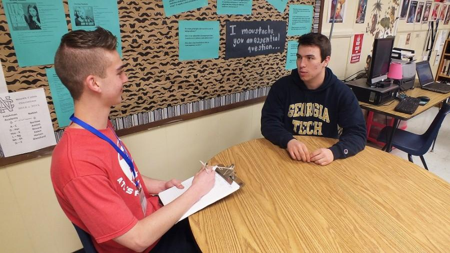 Sam Fulkerson discusses his baseball field position with Cameron Hines.