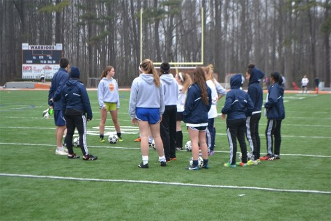 After the snow melted, the girls soccer team got their heads back in the game in their team huddle before practice.