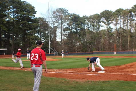 The batter from Osborne High School gets thrown out at first base by junior Shane Wiltsey.