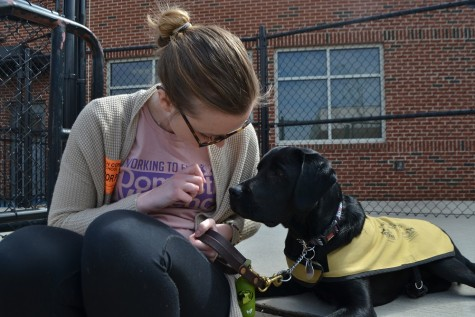 Maddie Swab and her best bud Navarro show their love for each other (and treats) while visiting Swab's alma mater on UGA's spring break.