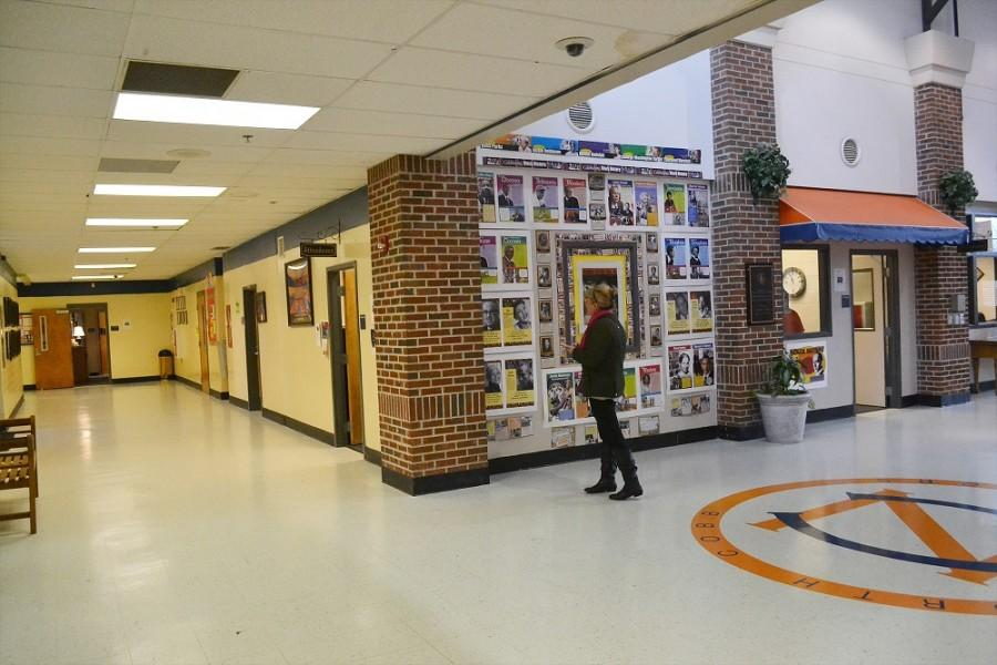 "While waiting to check out her son, sophomore Patrick Roberts, Kimberly Roberts indulges in a wall dedicated to the figures of African American history. ""I think it is important recognize the people that are genuinely good. Frederick Douglass was a good man,"" Roberts said. ""Some of my favorite quotes are from him….We should continue to teach our children about great people like him. These are the people our kids need to emulate."""