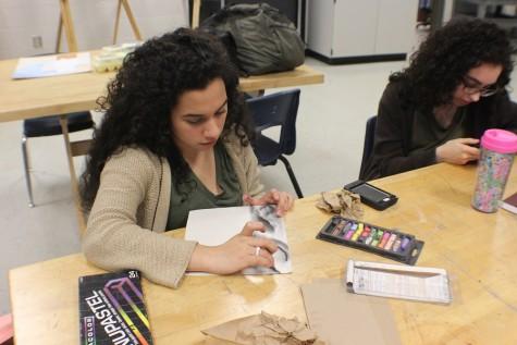 Junior Camila Mino and senior Sally Murtadhi  practice skills.