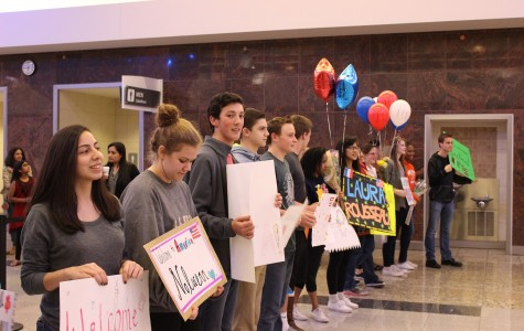 Host students line up in the International Terminal at Hartsfield-Jackson Airport with handmade signs to welcome the French Exchange students to the United States.