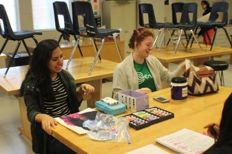 Seniors Annette Montero and Phoebe Graham collaborate.