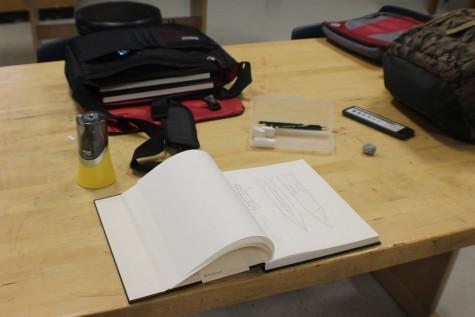 Senior Daniel Lee leaves his drawing book open for a peek inside.