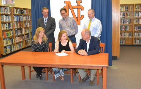 Enthused and amused by her father's comment, Duckett signs to Emmanuel College.