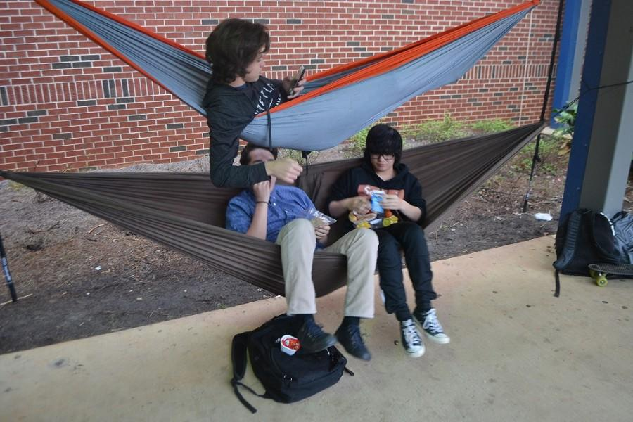While other students crowd the lunch tables, three NC boys creatively arrange their own dining area. Relaxing and fellowshipping on hammocks, junior JC Martinez and sophomores Zack Talent and Brady Hill provide interesting scenery in the courtyard.