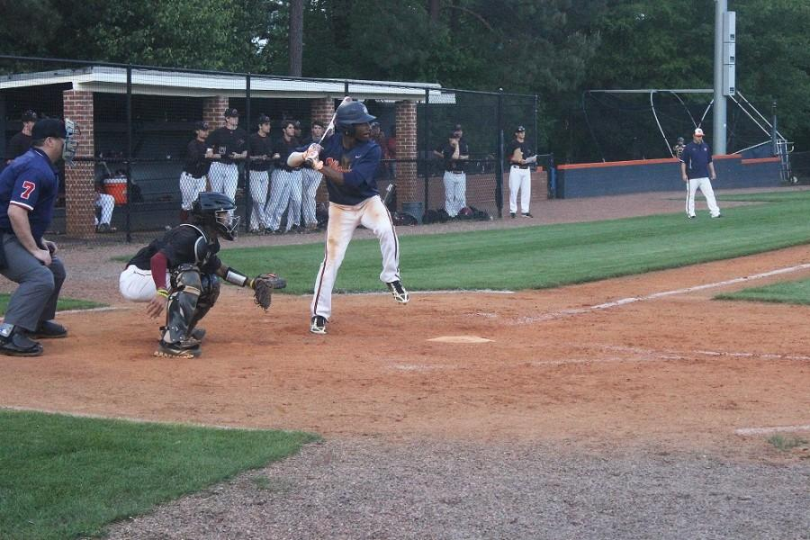 """Junior Trey Kirkland is up to pitch and ready to swing. Kirkland commented, """"We're up against a tough region opponent, but were putting up a good battle."""""""