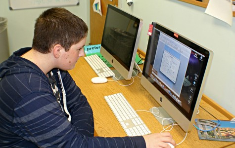 Freshman Alex Jenks shows off his Microsoft skills by changing the color of the background on a Word document.