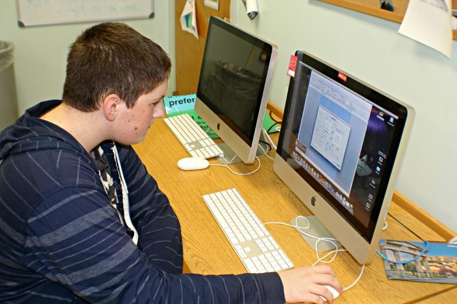 Freshman+Alex+Jenks+shows+off+his+Microsoft+skills+by+changing+the+color+of+the+background+on+a+Word+document.
