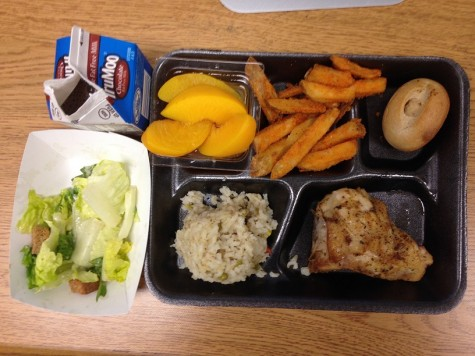 Main Dish: Roasted Chicken, Dinner Roll and Brown Rice Pilaf Sides: Potato wedges, corn, baked beans, and peaches
