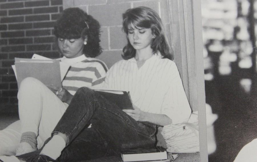 In honor of EOC and AP exam week, two juniors study for their upcoming final exams in the hallways in 1988.