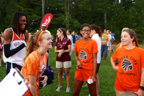 Seniors Stephan Gardner, Alishia Bowman, Brooke Shirer, and Junior Miah Dale joke around before the race begins. All four competed in the Varsity relay, running two miles before handing off a bracelet to other team members.