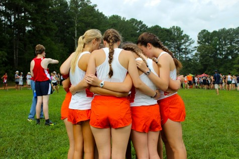The Varsity girls circle up before the race to pray, and then proceed to pump each other up and prepare themselves mentally for the challenge ahead.