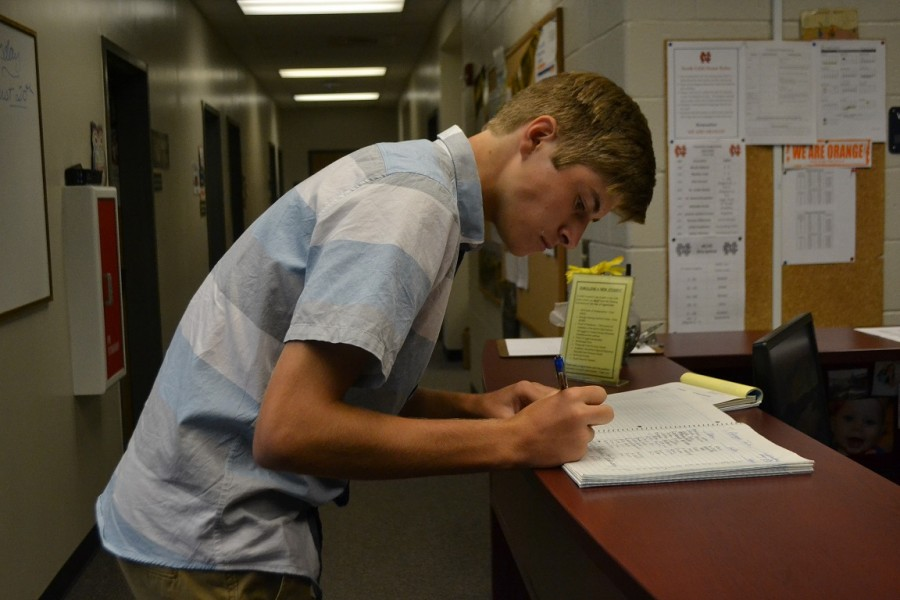 """Senior Devon DeLaMater signs up for one of the various colleges visiting in the next few weeks at NC. Upcoming dates include Scripps College at 8:30 am and Pace Academy at 2:15 pm on August 31st. """"I think it's a really good opportunity to discover colleges without missing a lot of school,"""" said DeLaMater. """"A lot of people can benefit from this type of system."""""""