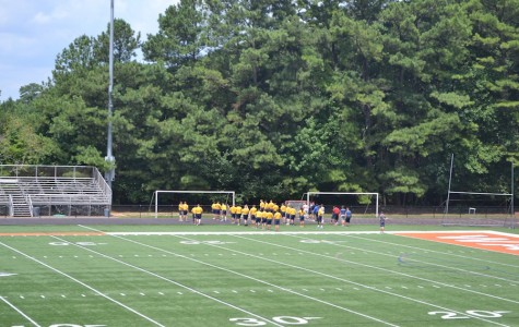 North Cobb NJROTC continues their warm up routine on the football field, while braving the summer heat.