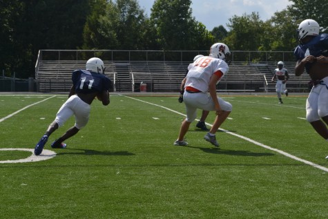 Dre Cottle (#11), Andrew Lubbers (#18), and Jai Erwin (#4) are shown during a punt return drill.