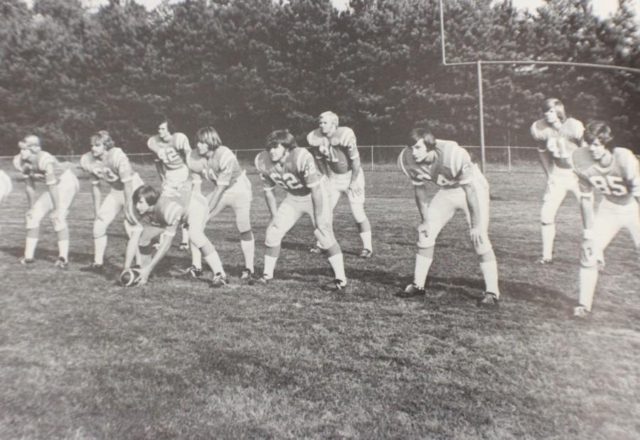 In 1974 the North Cobb football team warms up by doing stretched on the field before a big home game.