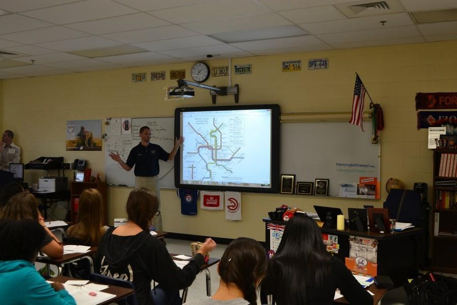 Coach Auld teaches his 3rd period AP Human Geography class.