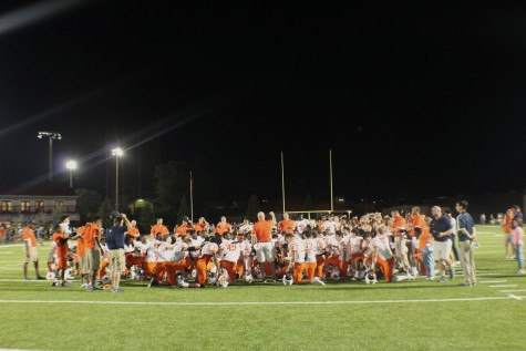 North Cobb's varsity and JV team in a prayer circle after winning against Lassiter 34-21.