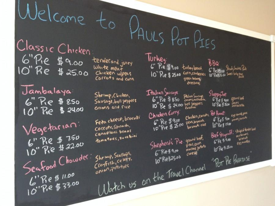 Inside the restaurant, Paul's Pot Pies' menu fills the wall, showcasing the delectable pies available.