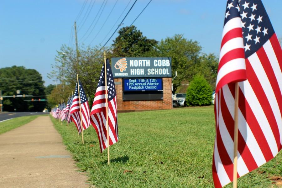 American flags line the sidewalk leading to NC to honor the fallen on September 11, fourteen years after the terrorist attacks that changed America.