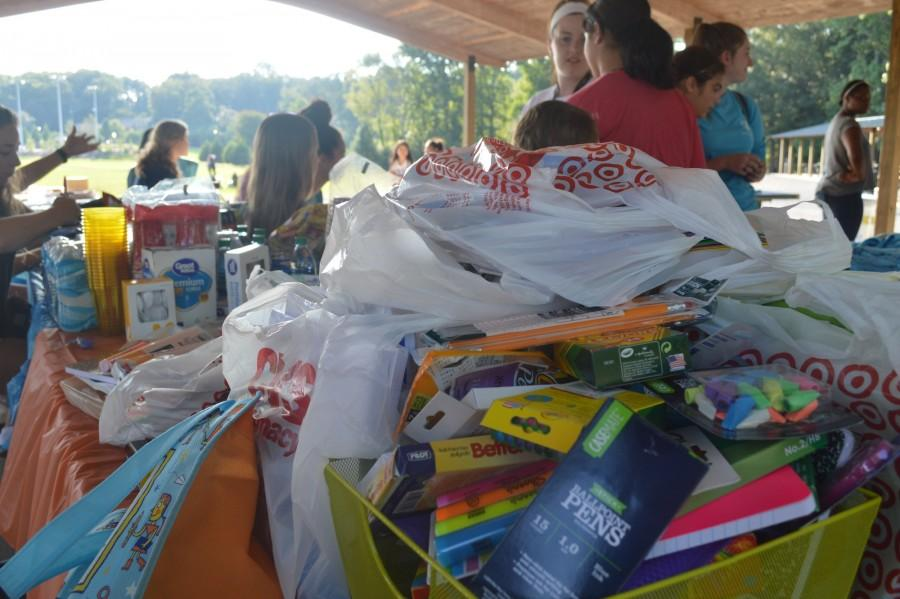 NC's National Honors Society chapter collects school supplies at their annual social event; the gathered supplies will go to Calvary Children's Home.