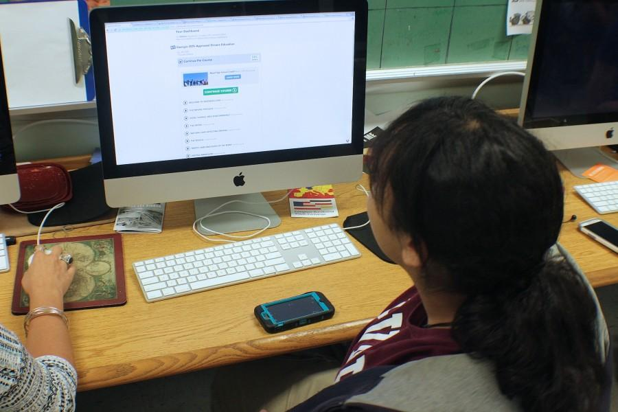 A student puts in their hours studying in an online class, in order to obtain the needed credit.