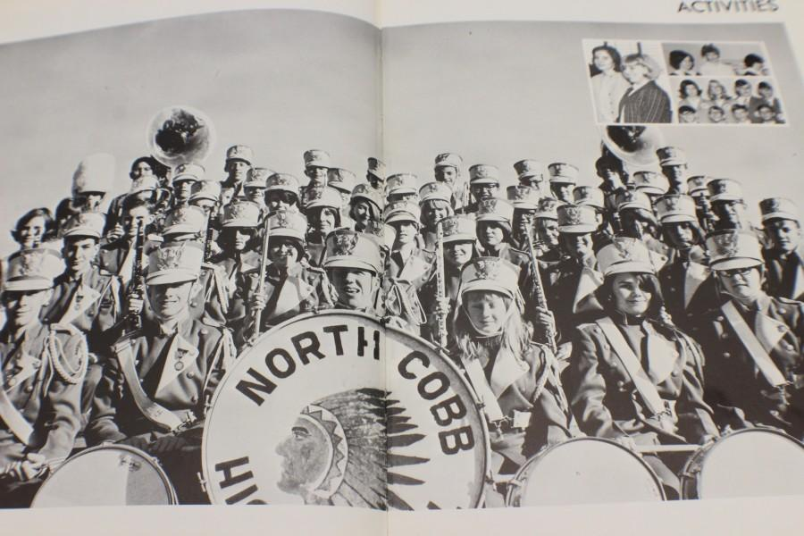 The 1965 yearbook show the marching band in the stands during the game, as they rallied the team and fans with their fight songs.