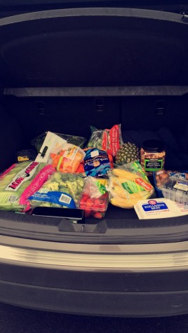My mom's trunk after our first round of paleo shopping. Contents include fresh fruit, vegetables, and mixed nuts.