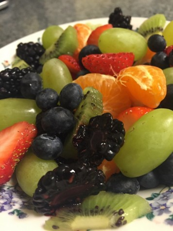 Fresh fruit salad with oranges, grapes, kiwi, and berries.