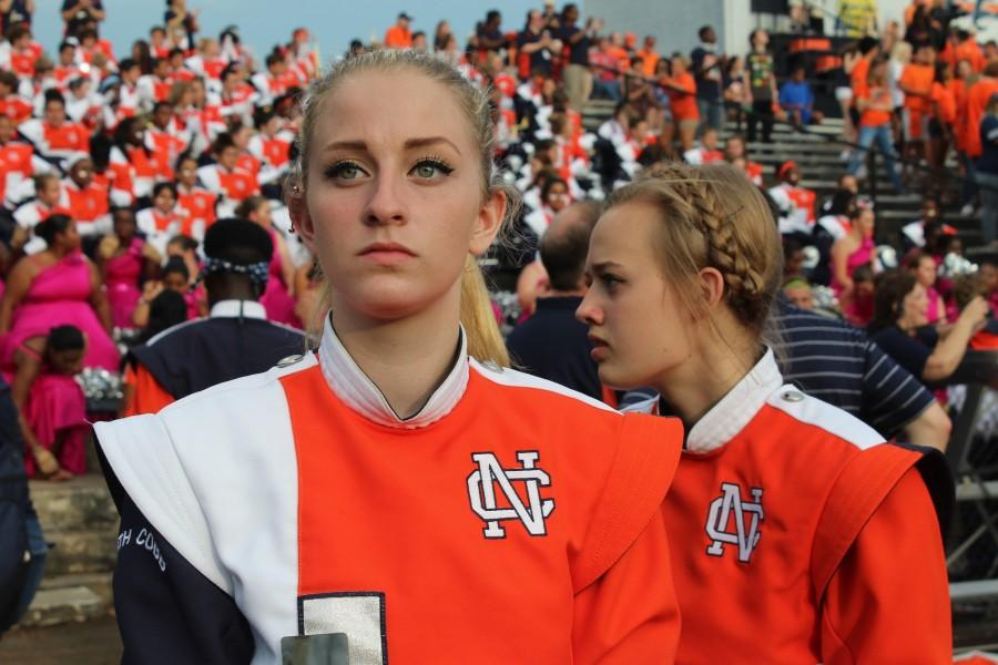 Sophomore Kaylin Altman gazes into the sunset as she embraces the North Cobb Marching Band environment and reflects upon her time at NCHS.