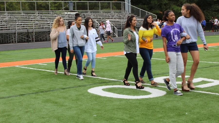 NC Homecoming Princess' practice the walk for their special moment under the stadium lights on the football field.