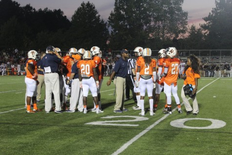 Coach Tener, Coach Carter, and Coach Rainey discuss the game plan during a time-out to the North Cobb defense.