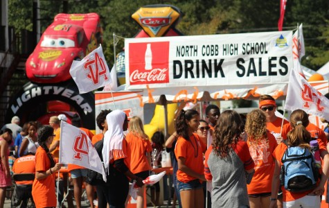 North Cobb students volunteered on Saturday to help out with the school's booth and promote school spirit.
