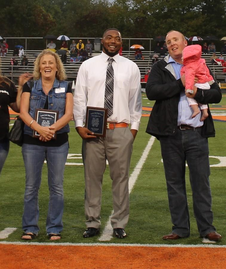 Davis (right) with his daughter while being honored during Friday's varsity game.