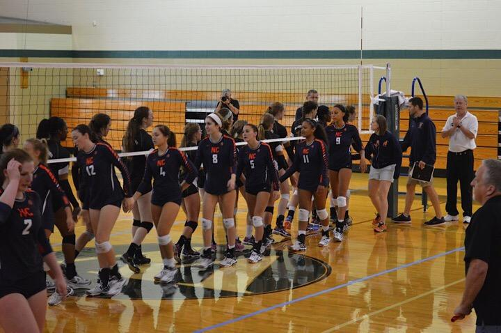 Varsity volleyball celebrates after their first win of the season. After a long season full of highs and lows, they were eliminated after the first round of the playoffs.