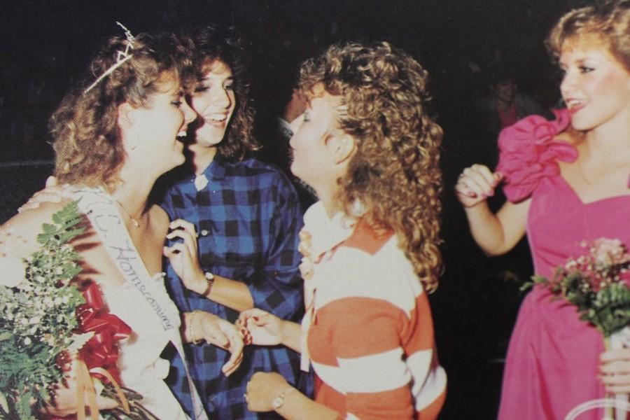 NC Homecoming Queen of 1986 celebrates her victory with her friends on the football field at the homecoming game.