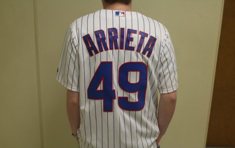 A Cubs fan shows their pride by sporting the jersey of their favorite player, number 49 Jake Arrieta, to school. The Cubs are predicted to triumph in NC's Major League Baseball wild card preview.
