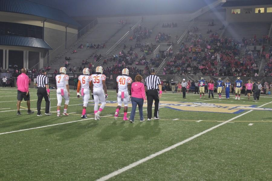 NC played the McEachern Indians at last Friday's varsity football game. As a part of breast cancer awareness, the Falcons sponsored a pink-out and encouraged the football players from both teams to sport pink gear.