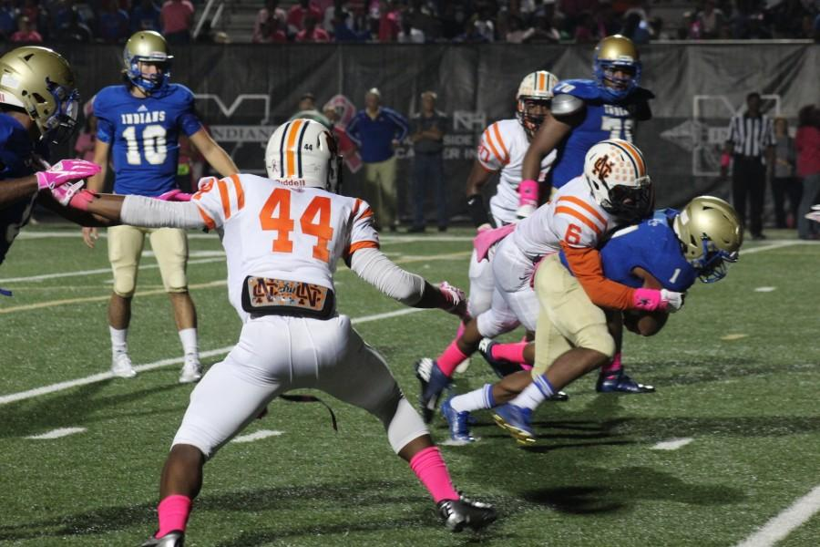 Senior Larry Bryant (#6) with the sack to the Indian's star player Sam Jackson (#1).