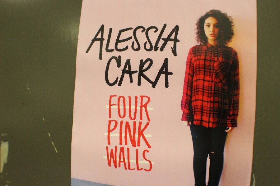 "Alessia Cara's album cover for ""Four Pink Walls"" is proudly displayed on The Chant's door."