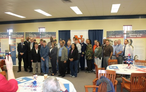 The invited veterans gather around for photos during the pre-ceremony breakfast.