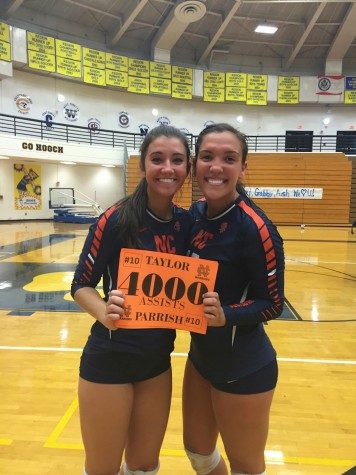 Parrish (right) smiles with teammate Shannon Callan after becoming one of three girls in state history to tally 4000 assists.