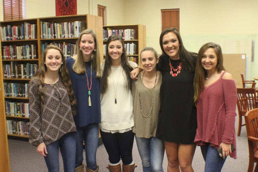 Early this morning, NC athletes gathered in the media center to commit to their dream colleges. Senior Taylor Parrish, pictured second to the right with her volleyball teammates, committed to University of West Alabama this morning. Parrish broke a number of records during her time on the Lady Warriors volleyball team, including becoming one of only three girls in the state to tally 4000 assists.